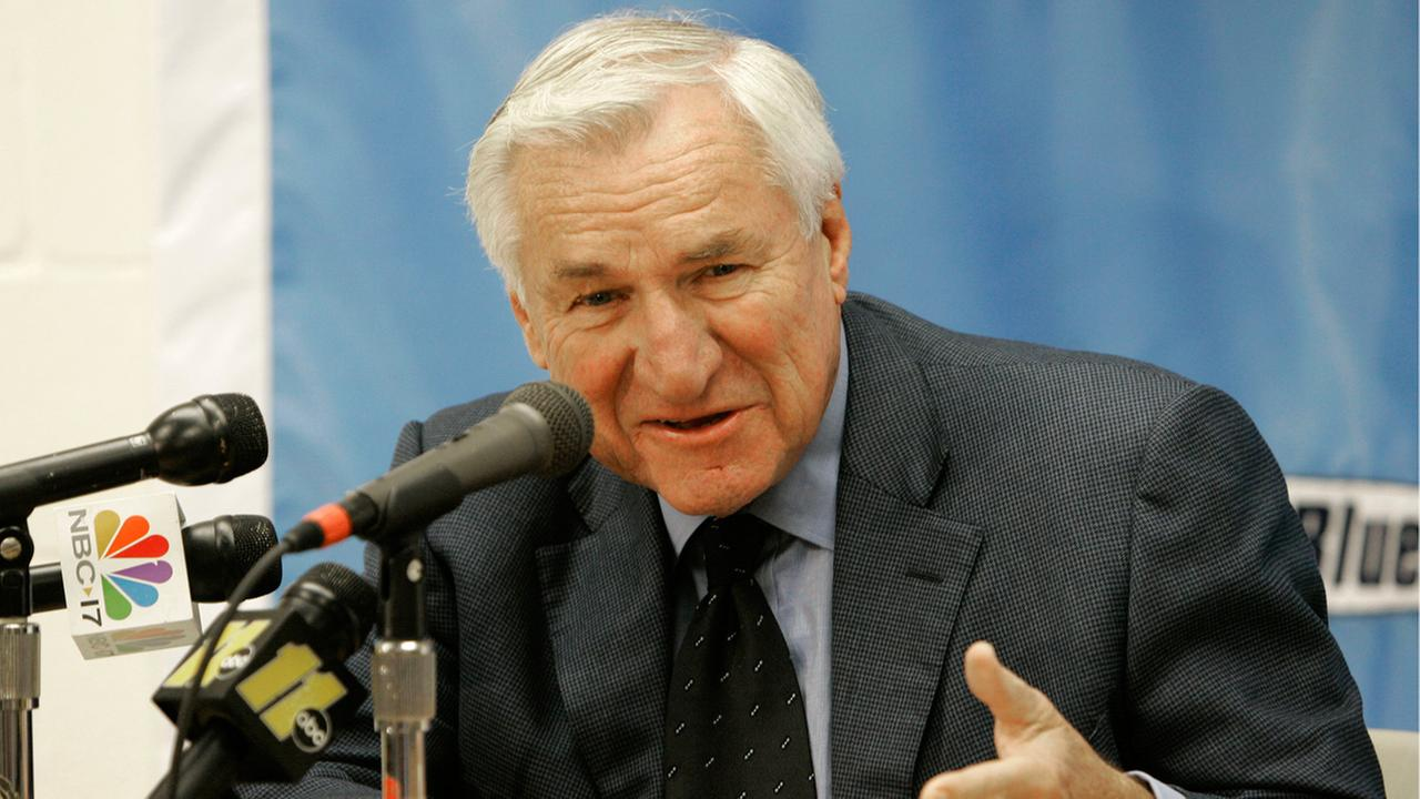 This Dec. 8, 2006 file photo shows former North Carolina basketball coach Dean Smith speaking during a news conference in Chapel Hill, N.C.