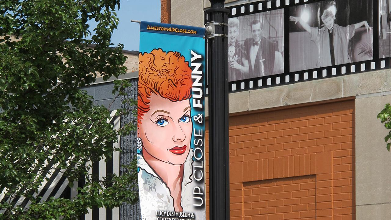 In this June 26, 2015 photo, a banner hangs outside the Lucille Ball-Desi Arnaz Museum in Balls hometown of Jamestown, N.Y.