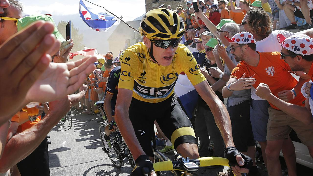 Britains Chris Froome, wearing the overall leaders yellow jersey, climbs towards Alpe dHuez during the twentieth stage of the Tour de France.
