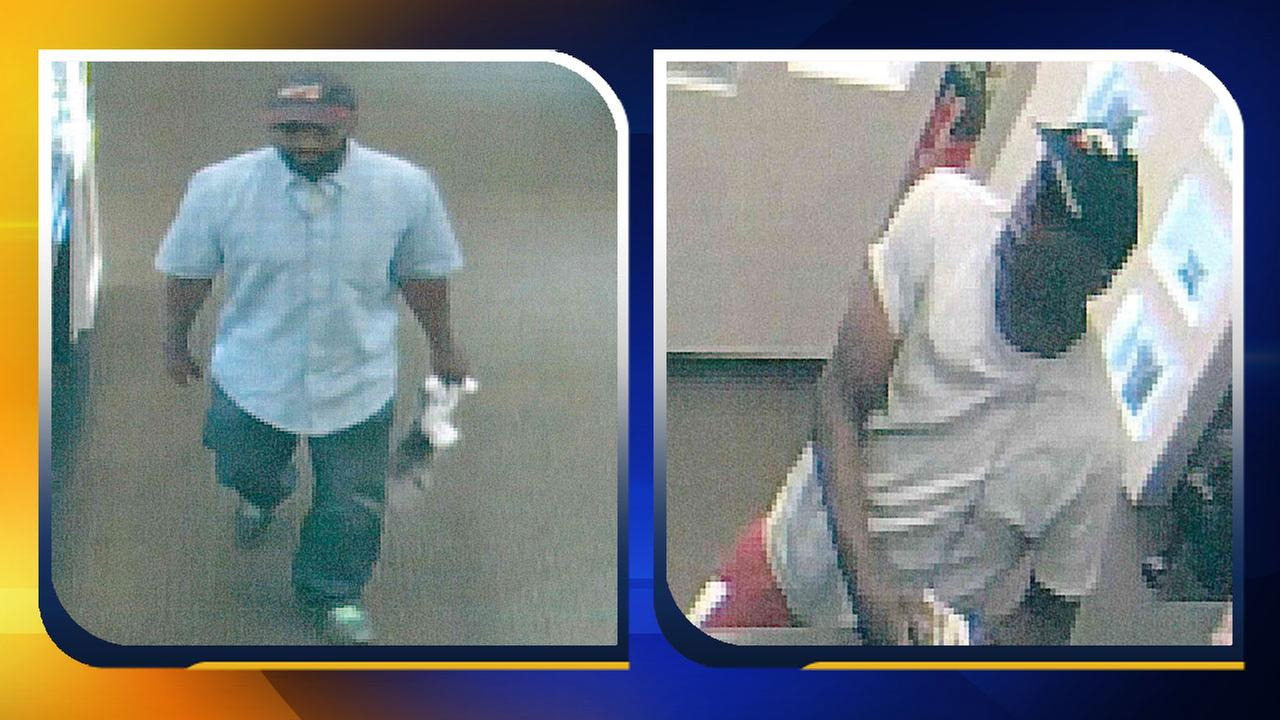 Surveillance photos of two robbery suspects at McNeills Jewelry Store in Lumberton