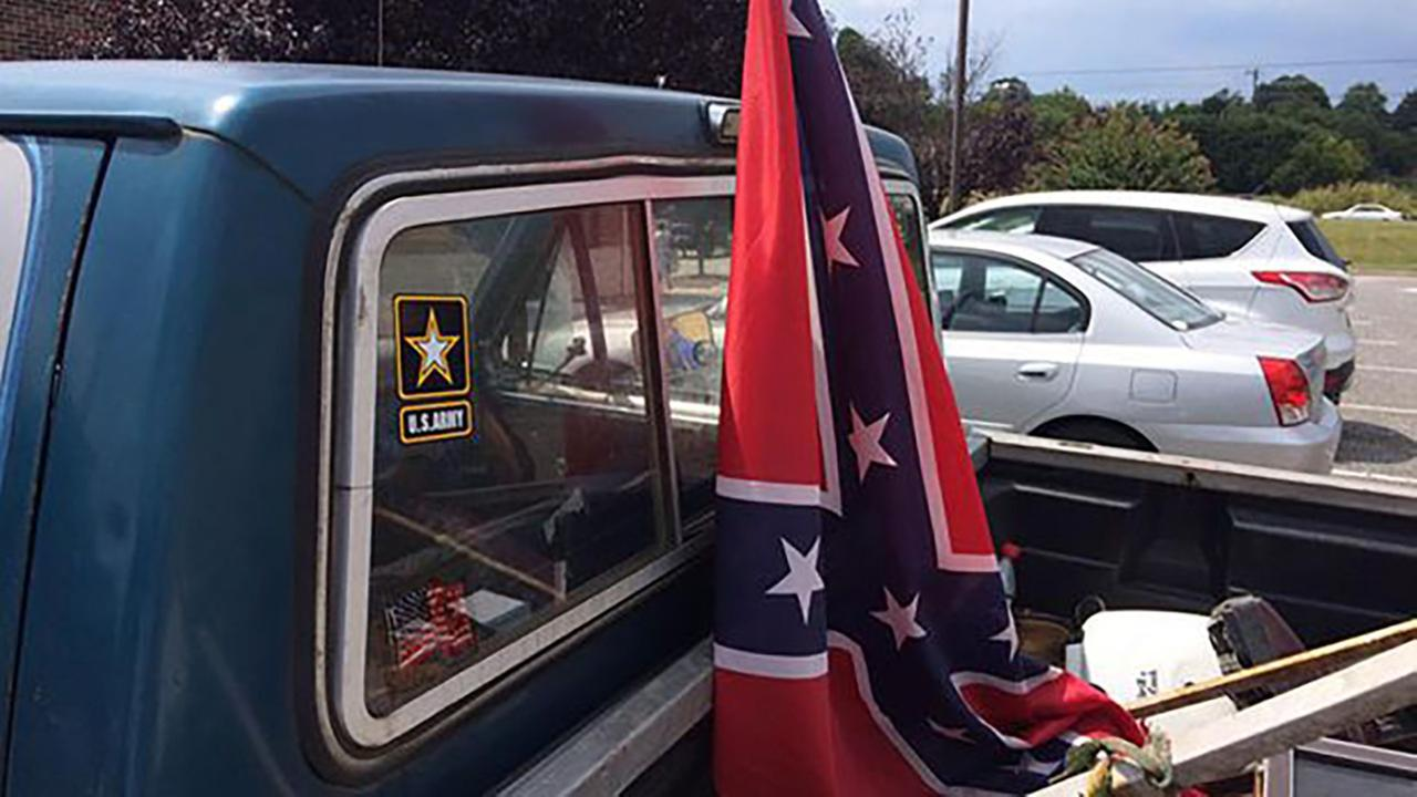 Example of Confederate flag flying from back of truck