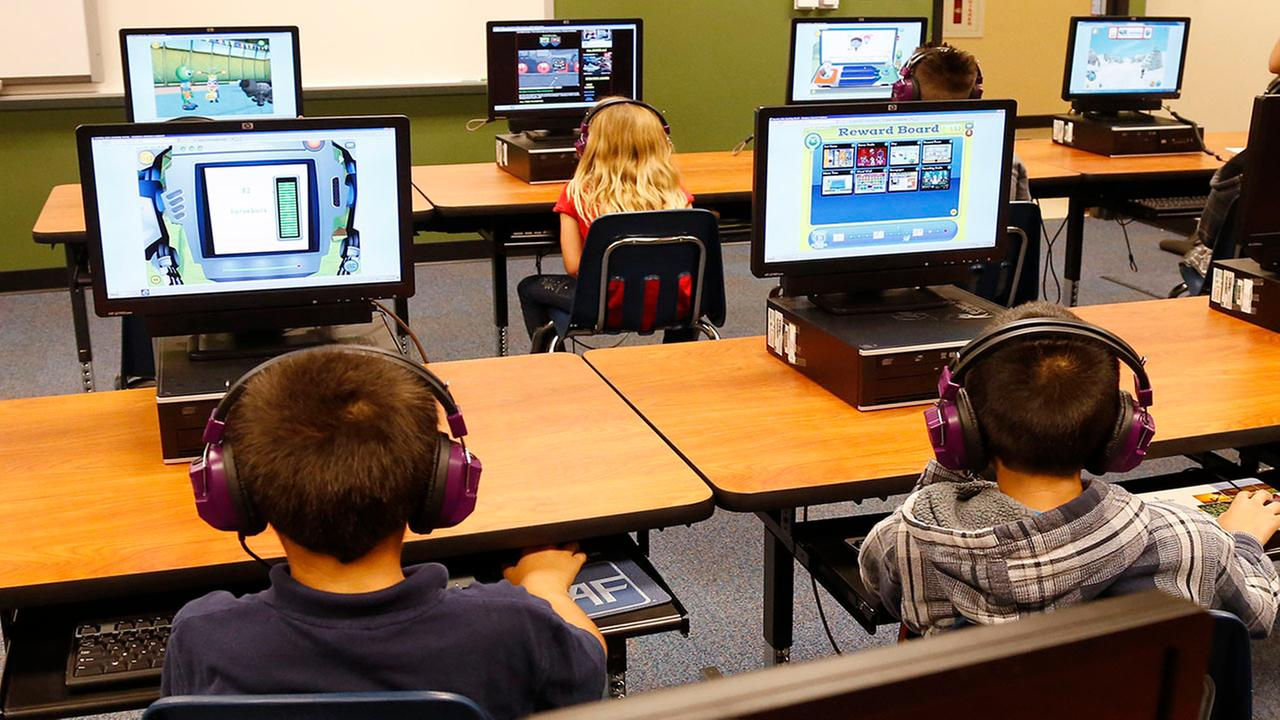 In this July 21, 2014 file photo, students at a summer reading academy at an elementary school work in the computer lab