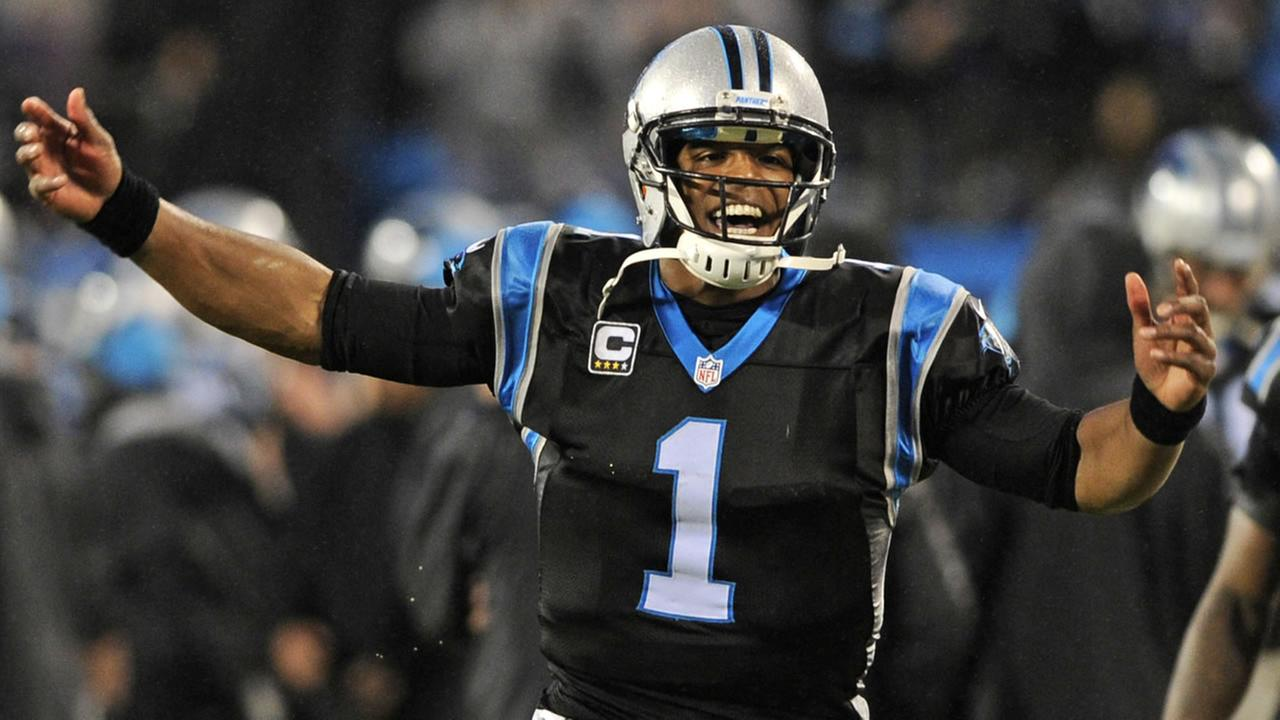 Carolina Panthers Cam Newton celebrates a Panthers touchdown against the Indianapolis Colts.