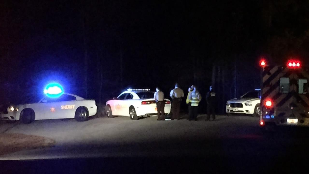 Deputies investigate after the shooting.