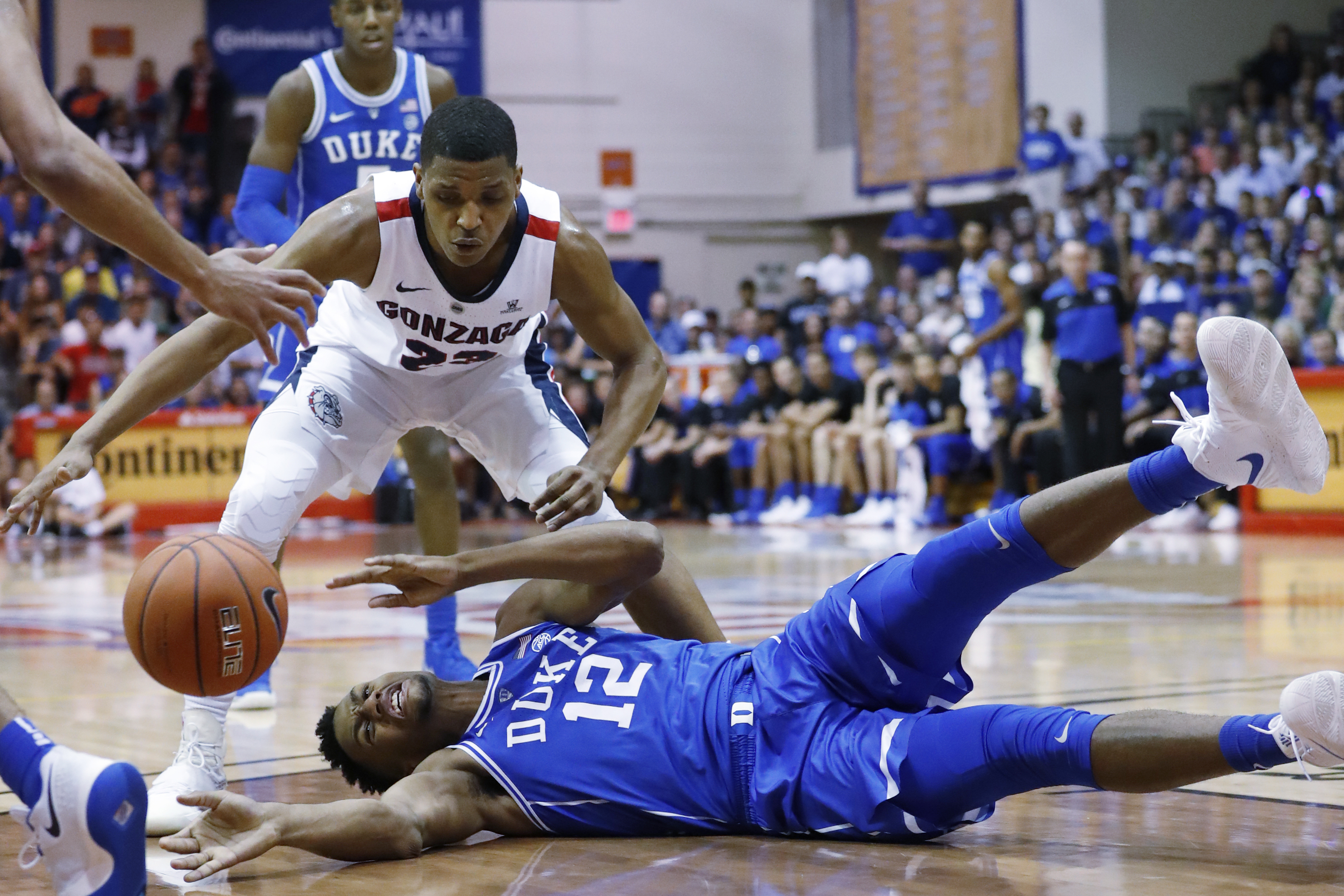 Duke forward Javin DeLaurier (12) loses the ball while being guarded by Gonzaga guard Zach Norvell Jr. on Wednesday in Lahaina, Hawaii.