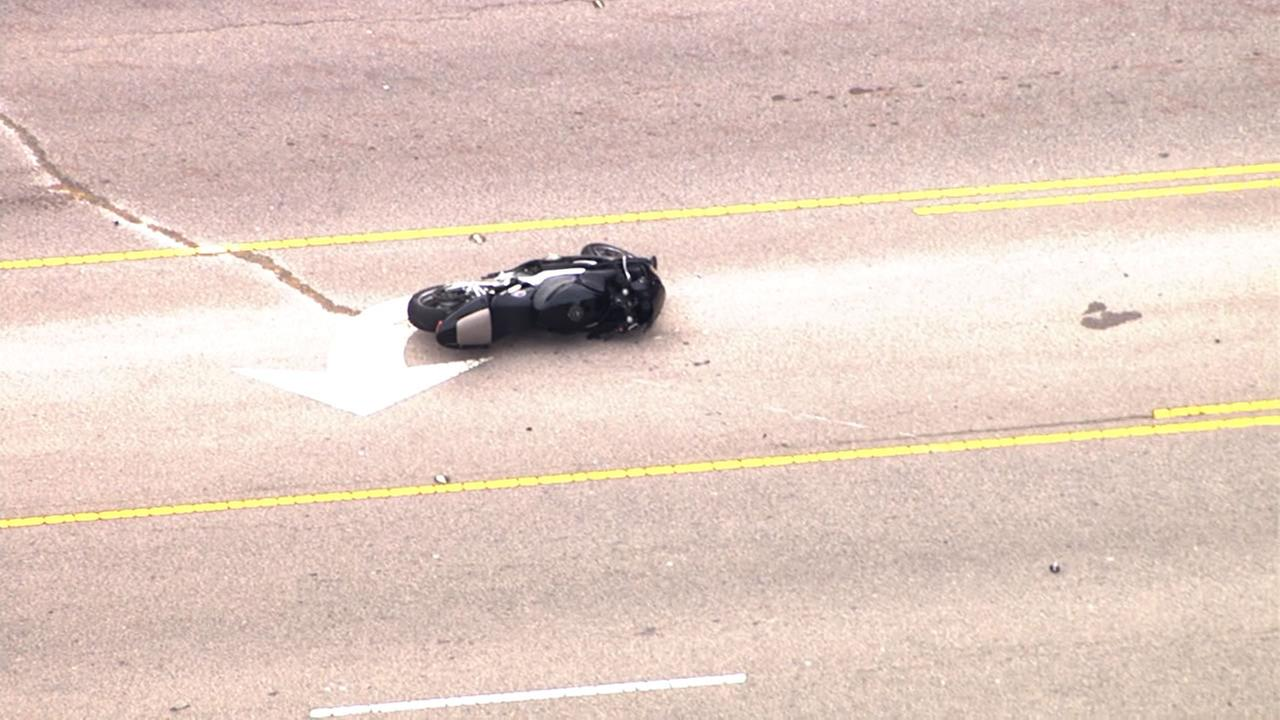 The bike was lying on the pavement after the crash.