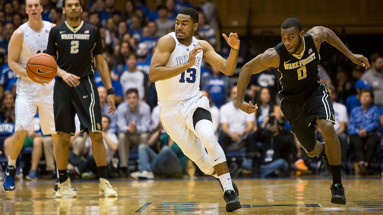 Dukes Matt Jones (13) and Wake Forests Codi Miller-McIntyre (0) chase a loose ball Tuesday night.