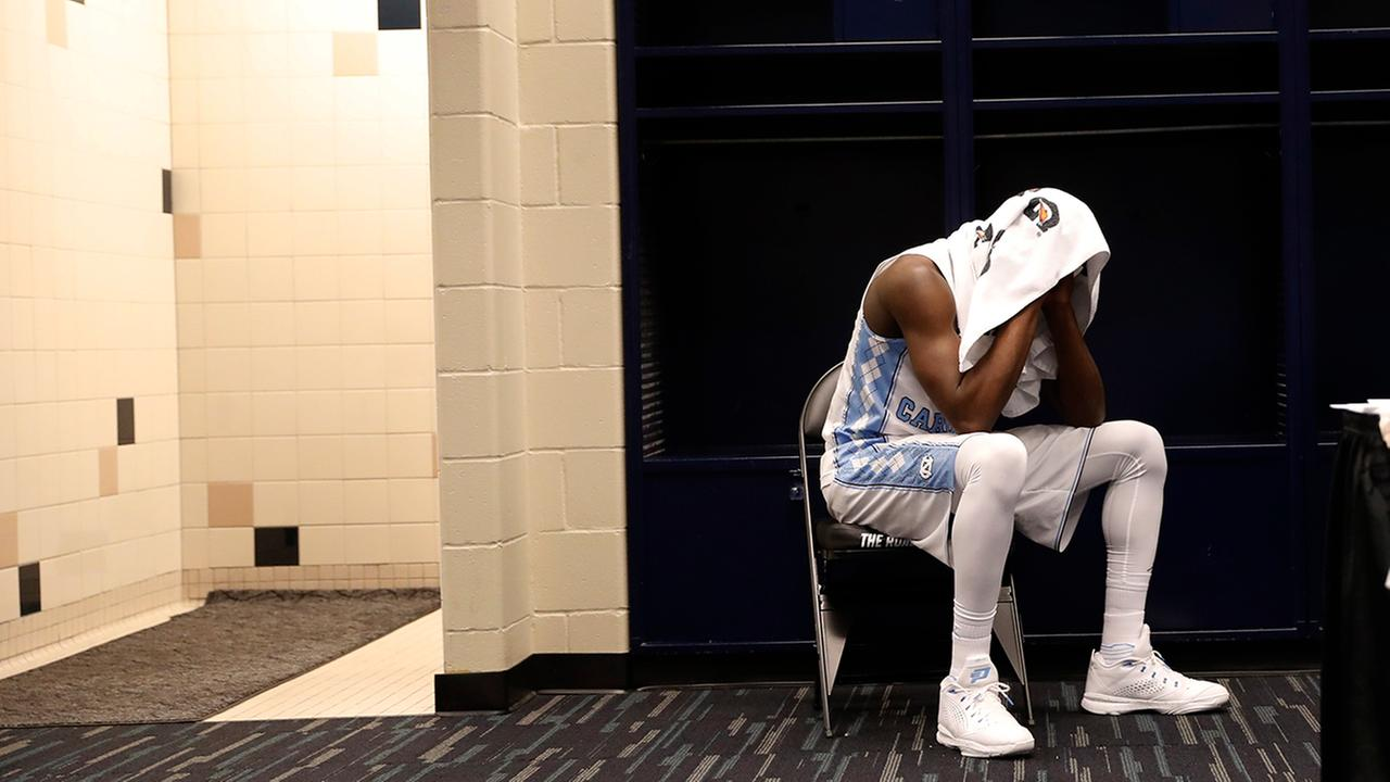 North Carolinas Theo Pinson sits in the locker room after the NCAA Final Four tournament college basketball championship game against Villanova, Monday, April 4, 2016, in Houston. Villanova won 77-74. (AP Photo/Eric Gay)
