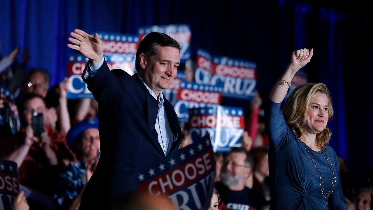 Ted Cruz, seen here Monday with wife, Heidi, told a somber crowd in Indianapolis on Tuesday that he was suspending his campaign.