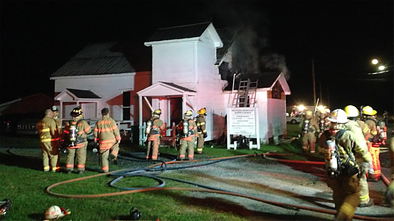 Firefighters battle the church fire on Tuesday night.