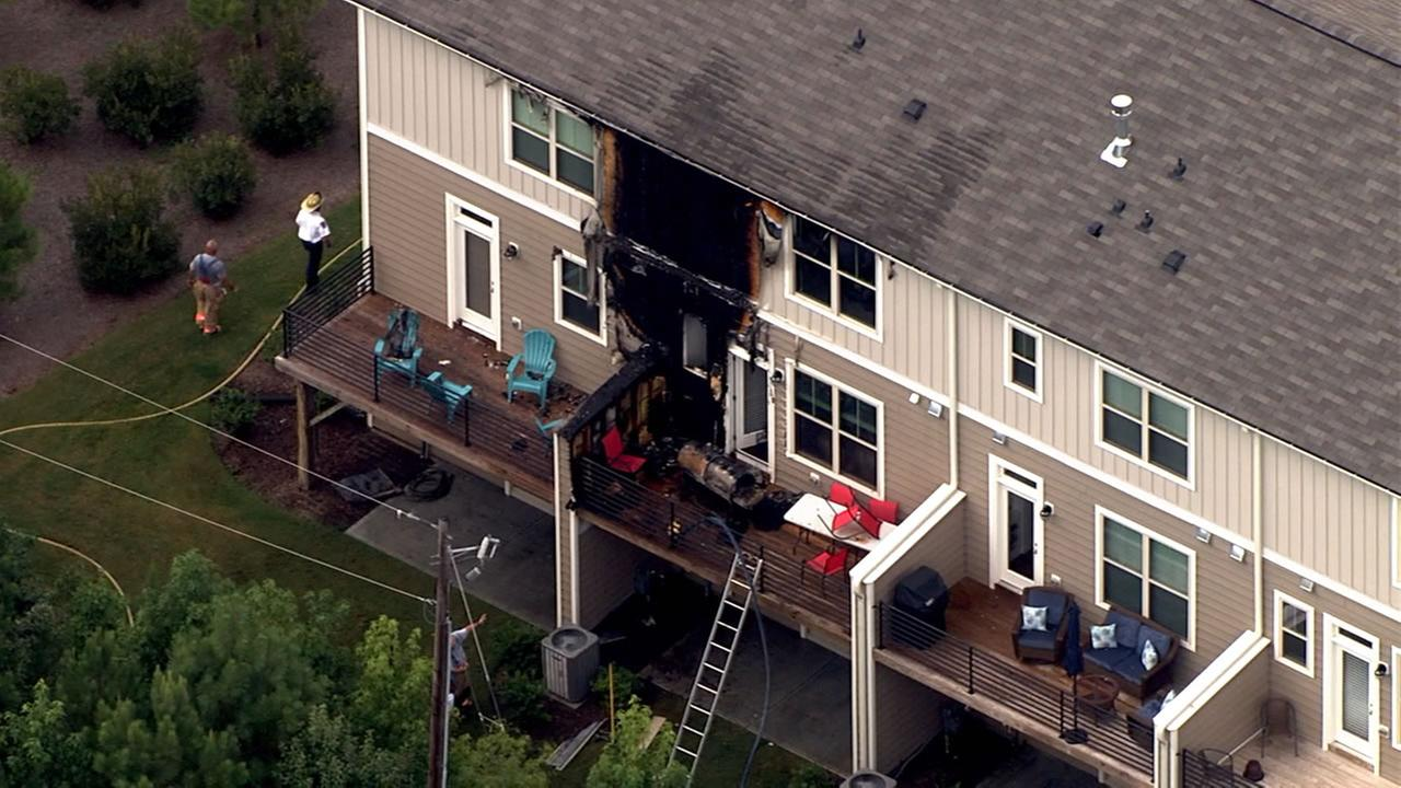 Fire burns hole in Cary townhomes