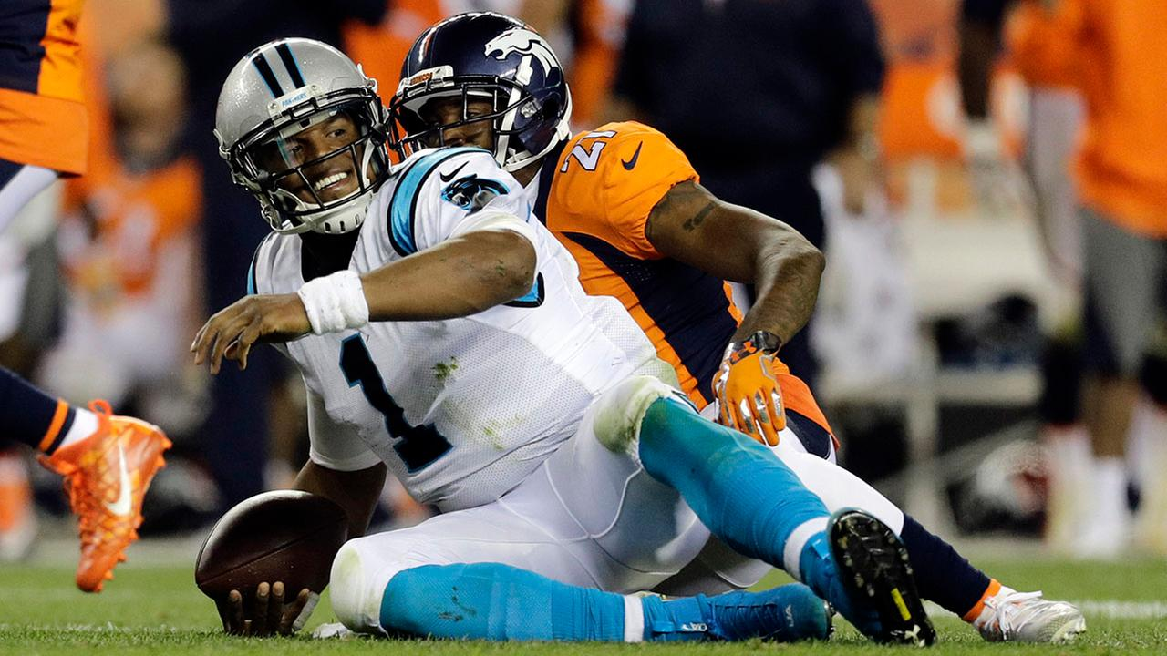Panthers quarterback Cam Newton sits after taking a hit against Denver.