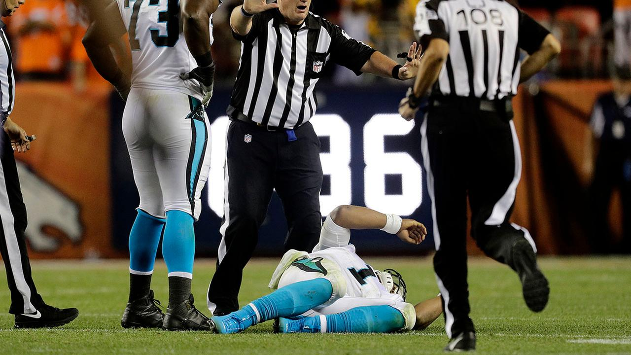 Cam Newton lies on the turf after getting drilled on a helmet-to-helmet hit by Broncos safety Darian Stewart on Thursday in Denver.