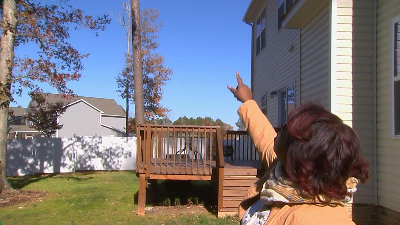 Cassetta Scott points to the trees she wanted cut down. Shes still waiting, more than a month later.