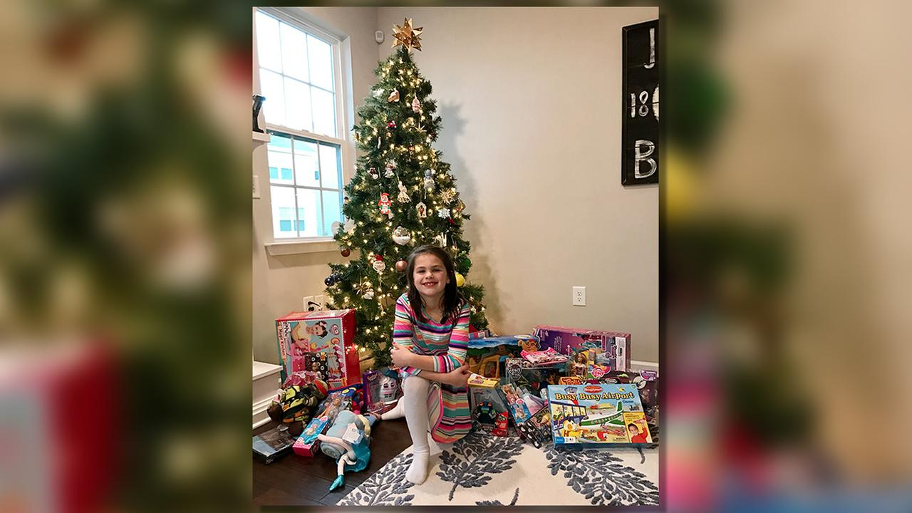 Grace Buckley poses with a lot of presents ... but her list wasnt for herself, but for foster children this Christmas.