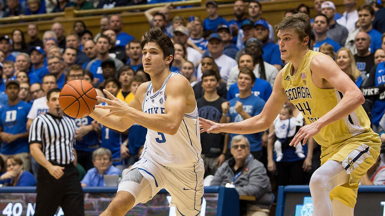 Dukes Grayson Allen, returning from a one-game suspension, drives against Georgia Techs Ben Lammers on Wednesday night.