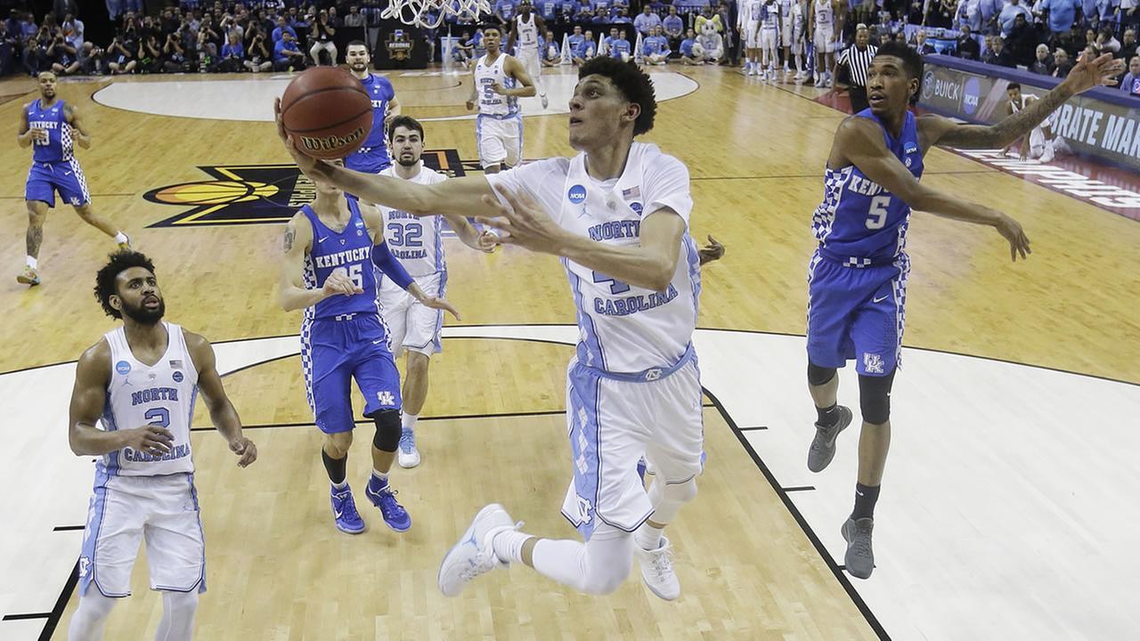 North Carolina forward Justin Jackson (44) shoots against Kentucky