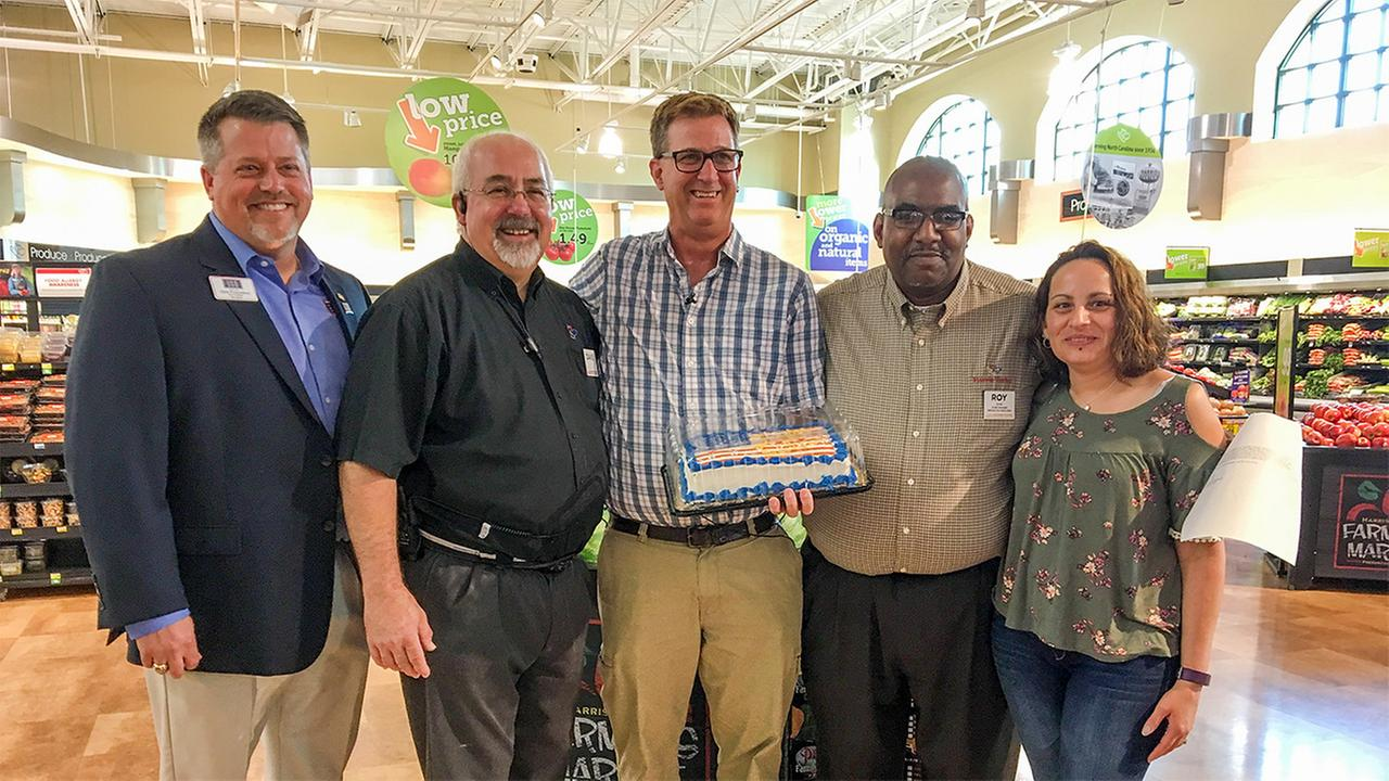 Rod Boyle, center, a veteran who received a nasty note while he was at the grocery store, was invited back to that store for an apology.