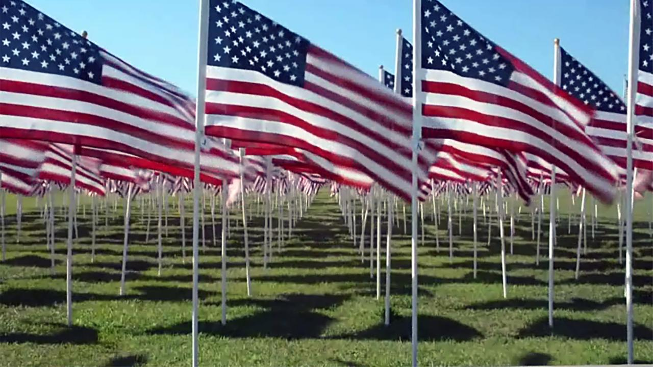 The field of honor, where every flag has the name of a fallen veteran attached.
