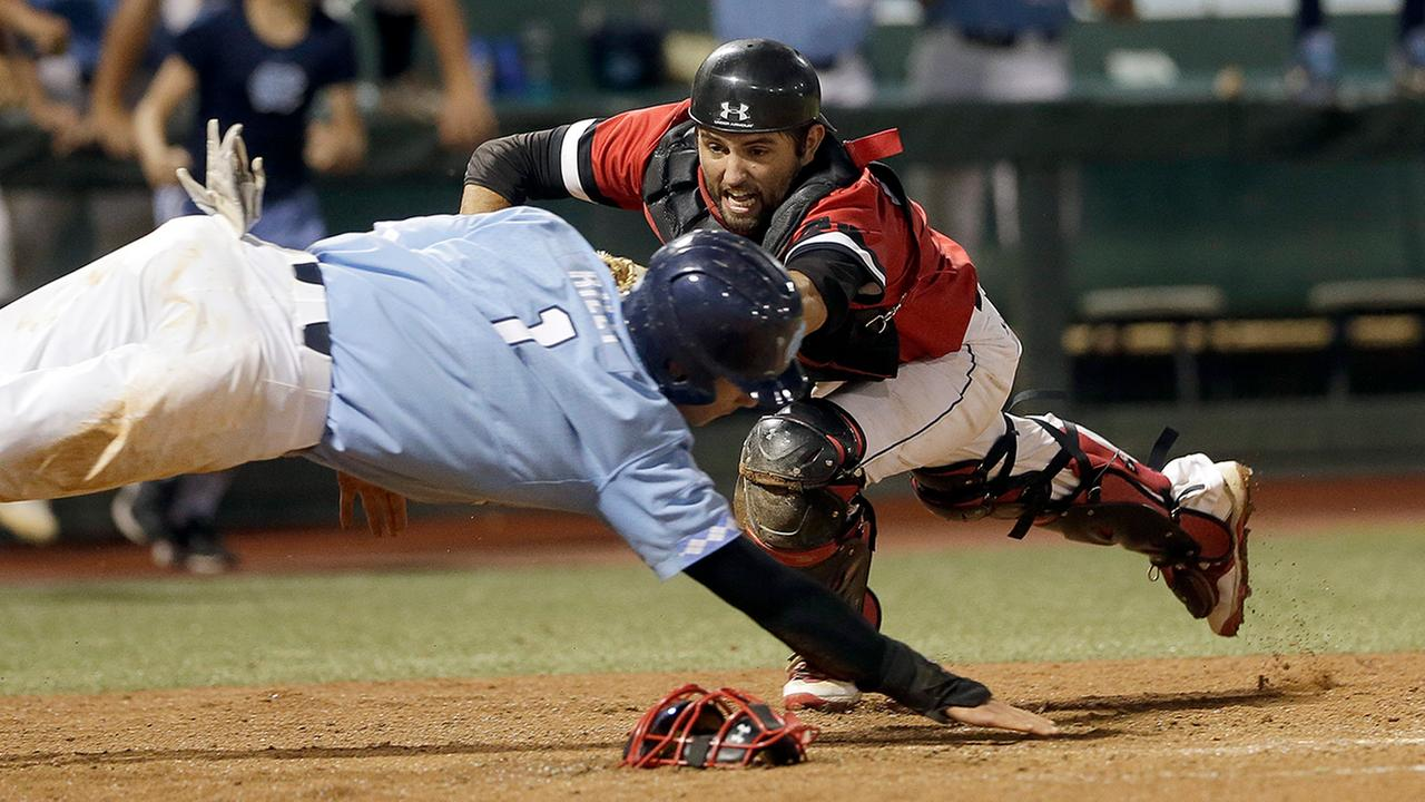Davidson catcher Jake Sidwell tags out North Carolinas Brandon Riley at home plate Sunday in the ninth inning in Chapel Hill.
