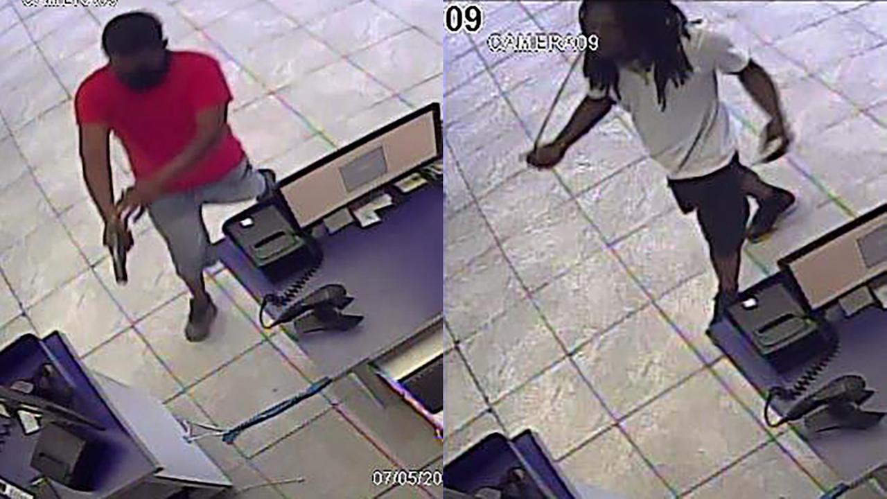 Durham police investigators are trying to identify two men suspected of robbing Metro PCS at 1603 Guess Road on July 5.