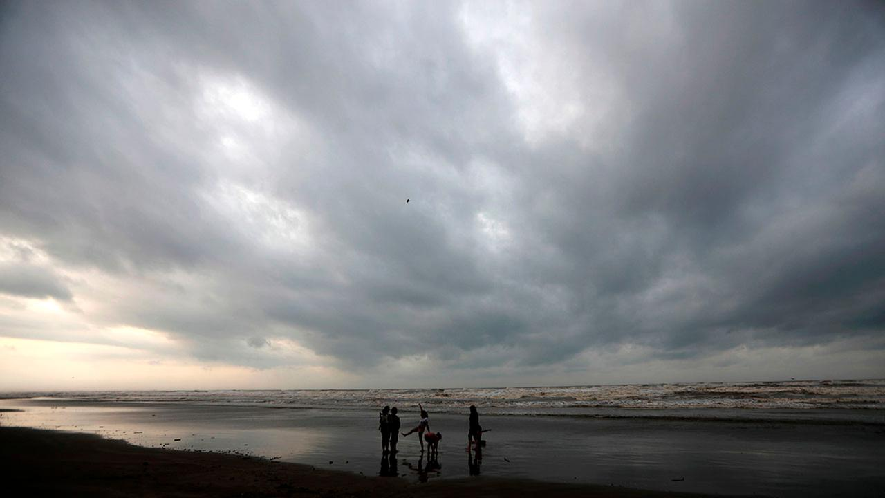People walk on the beach before the arrival of Hurricane Katia, in Tecolutla, Veracruz state, Mexico, Thursday,