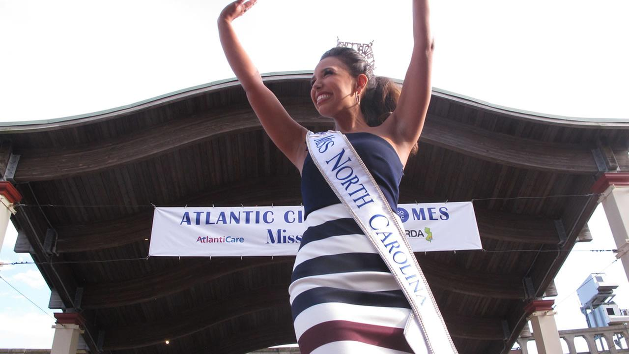 Miss North Carolina Victoria Huggins greets the crowd during a welcome ceremony for Miss America contestants in Atlantic City, N.J. (AP Photo/Wayne Parry)