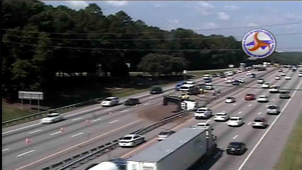 Overturned dump truck spills cargo, closes eastbound lanes on I-40 eastbound in Cary