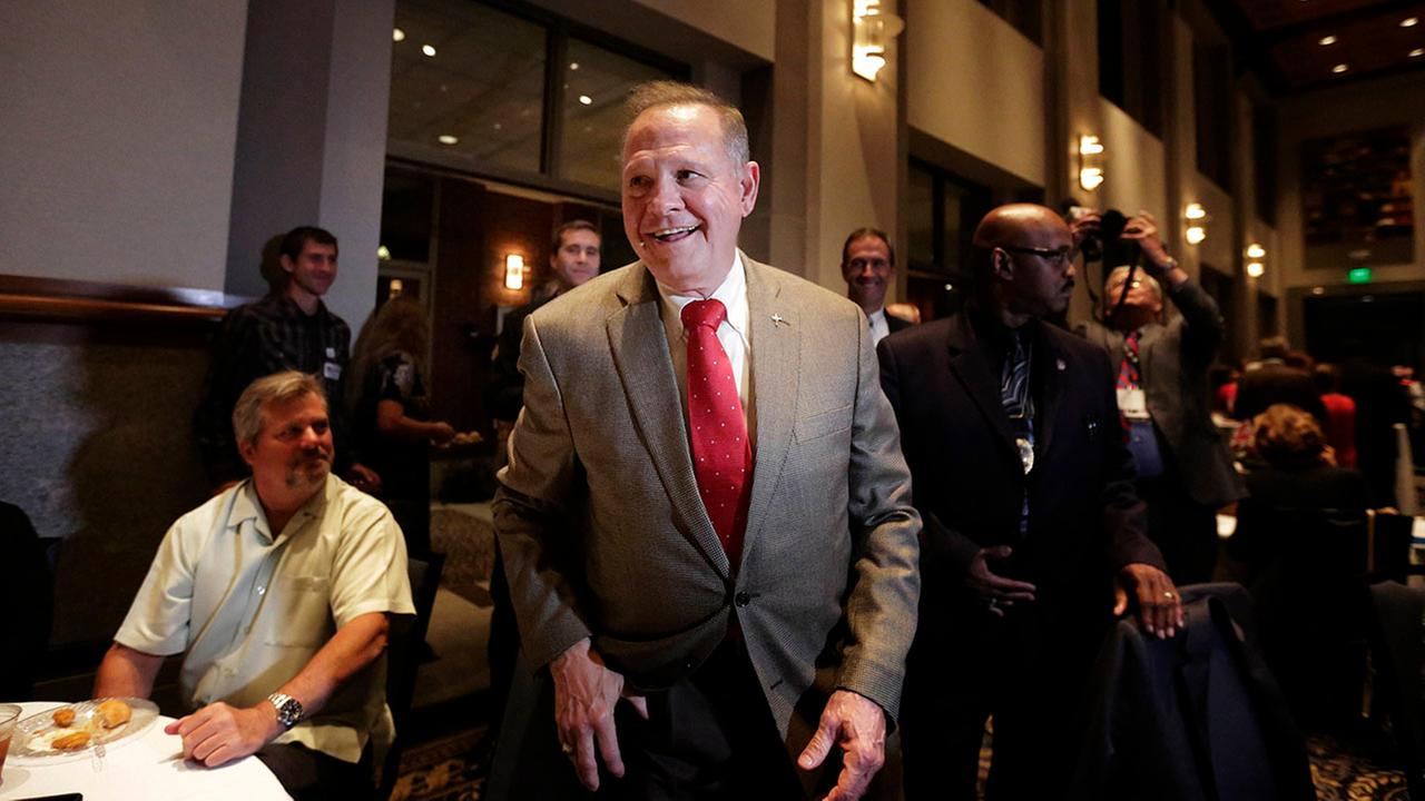 Former Alabama Chief Justice Roy Moore, greets supporters before his election party, Tuesday in Montgomery, Ala.