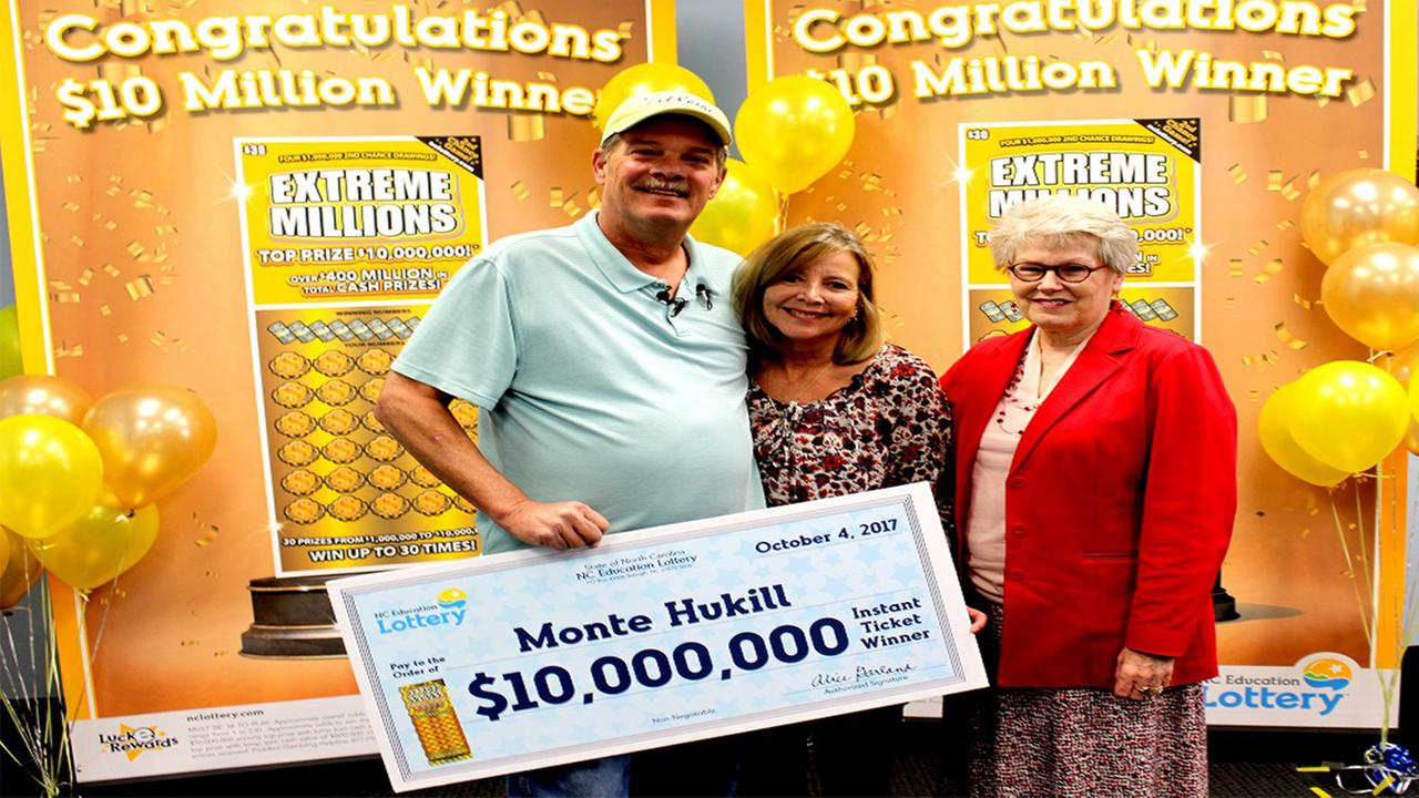 Monte Hukill and his wife Gage claiming their prize