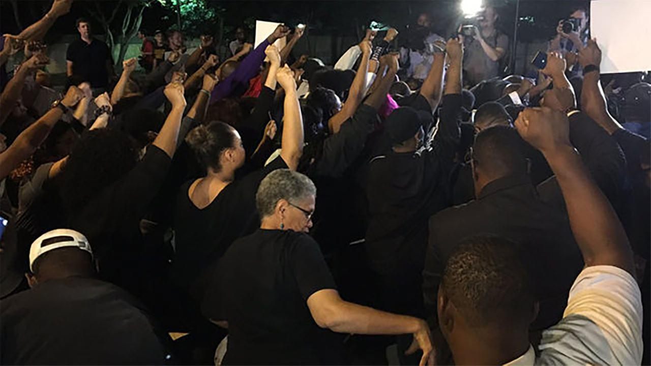 Church members took a knee outside Bank of America Stadium before the Thursday night football game.