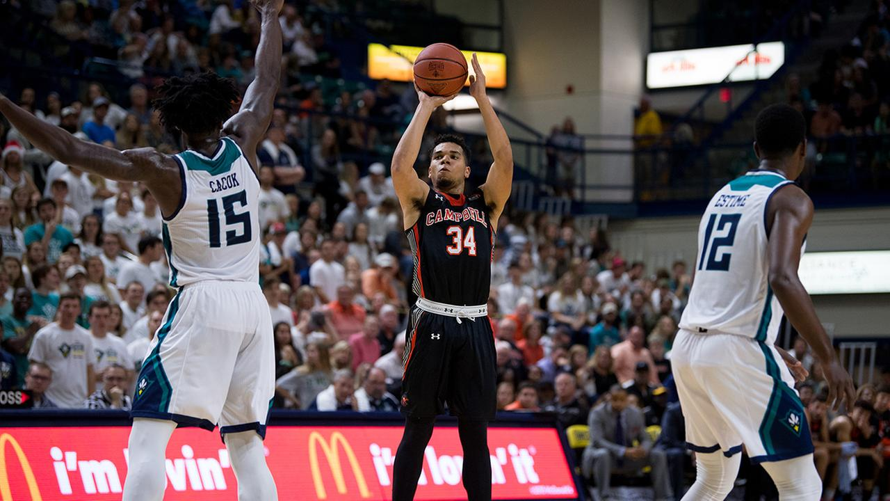 Campbells Marcus Burk shoots for two of his 33 points against UNC-Wilmington on Saturday.