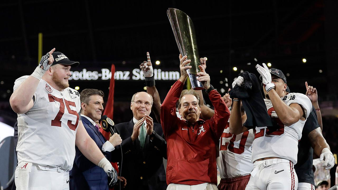 Alabama head coach Nick Saban holds up the championship trophy after the overtime win against Georgia on Monday night.