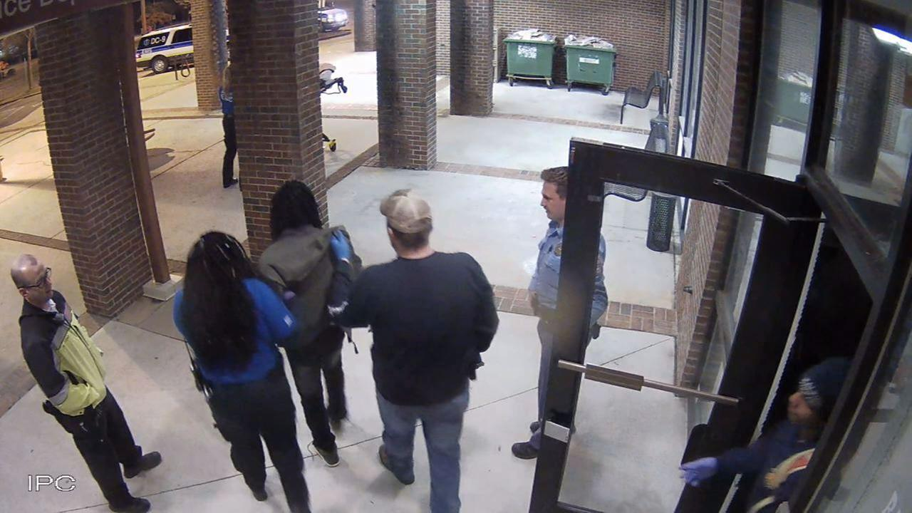 This surveillance image shows Curtis Mangum being helped to a waiting stretcher for treatment.
