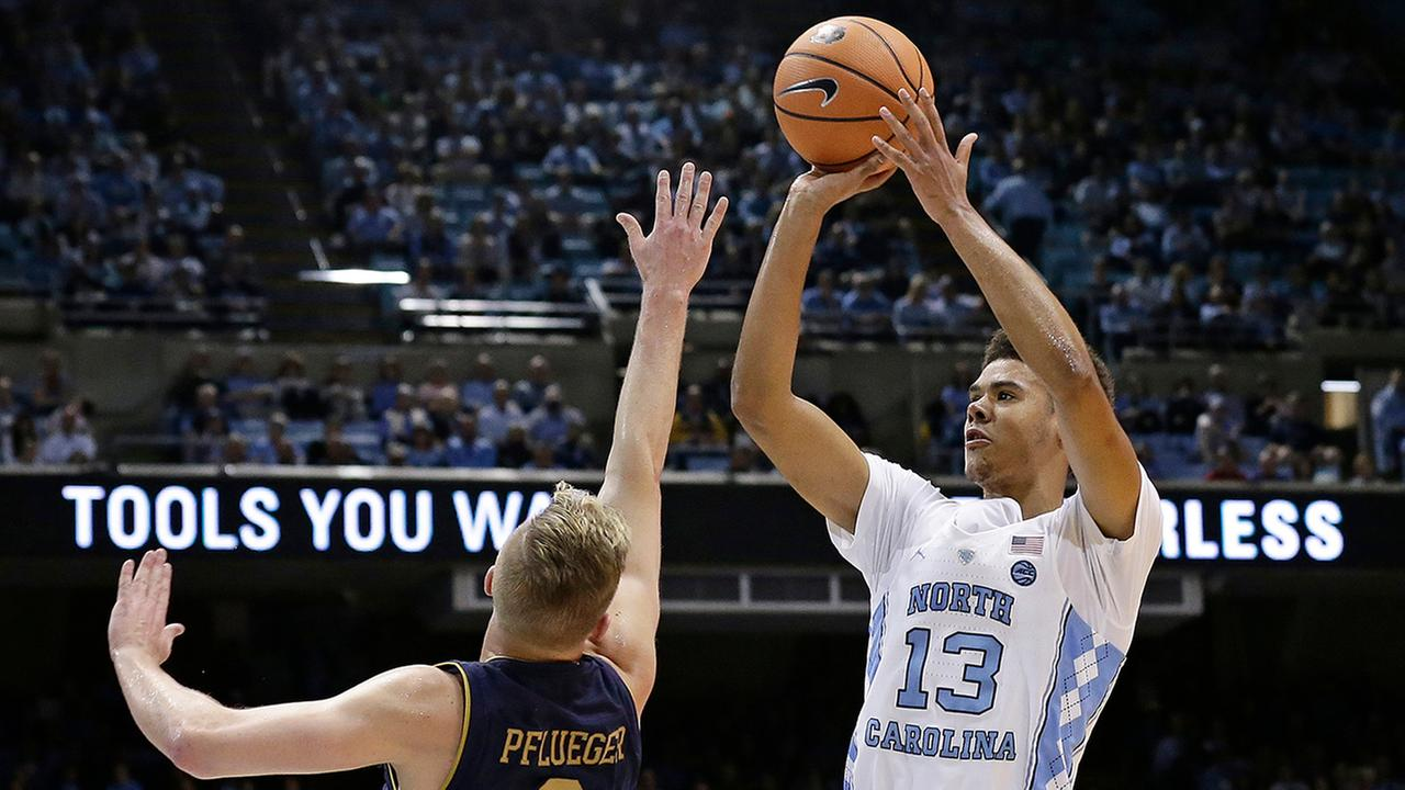 North Carolinas Cameron Johnson shoots over Notre Dames Rex Pflueger on Monday in Chapel Hill.