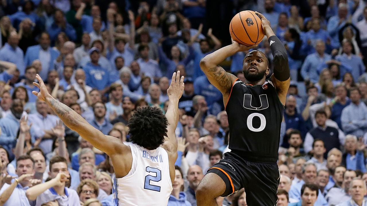 Miamis JaQuan Newton (0) shoots the game-winning shot as time expires while North Carolinas Joel Berry II (2) defends Tuesday in Chapel Hill.