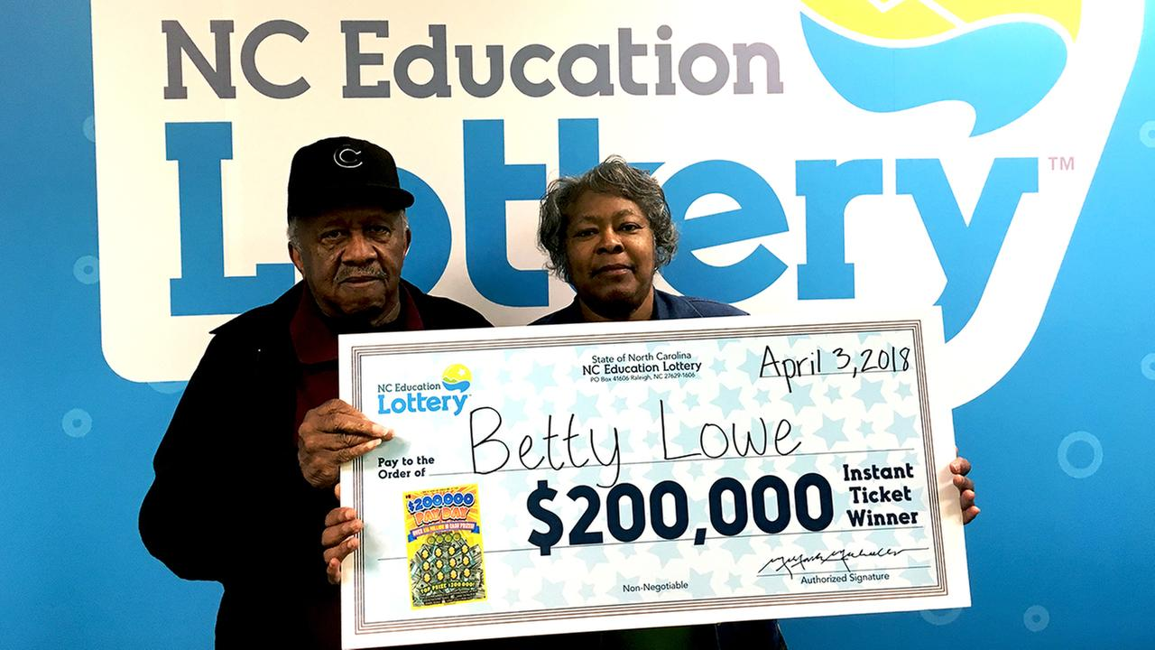 Betty Lowe with her winnings.