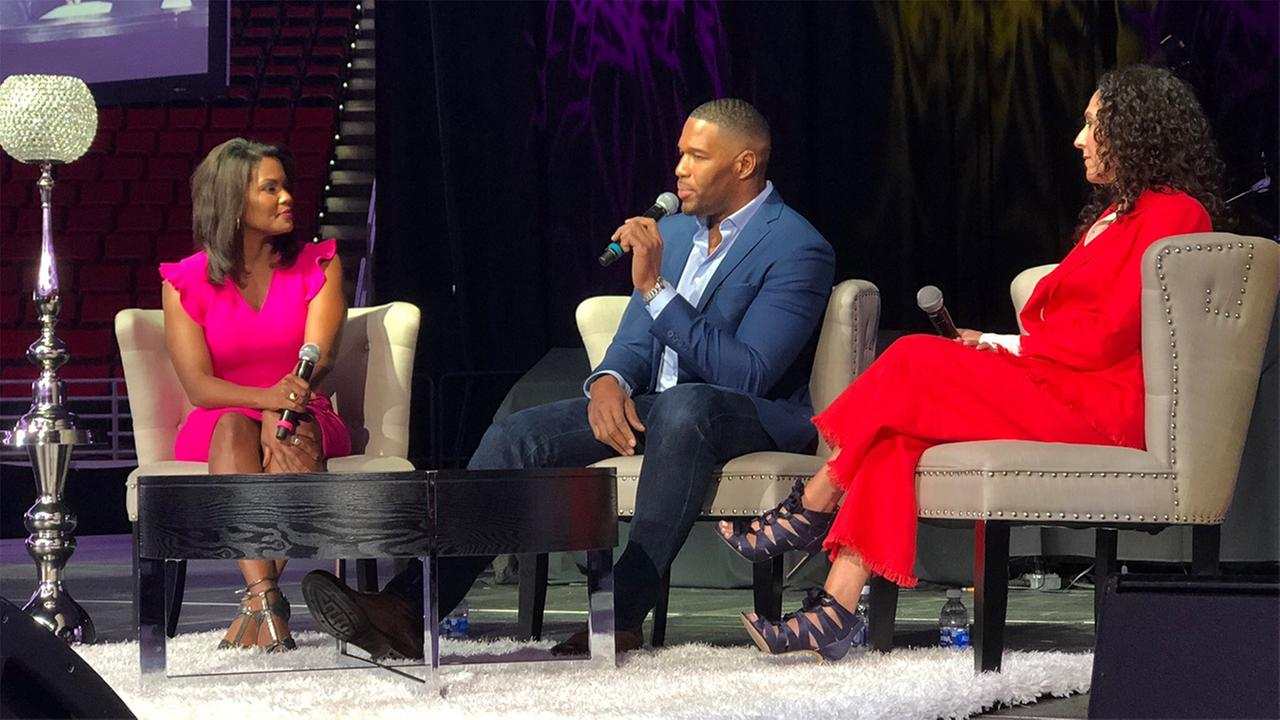 ABC11s Tisha Powell left, joins Michael Strahan at Womens Empowerment on Saturday.