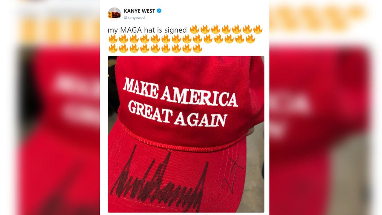 Trumps signs Kanyes MAGA hat