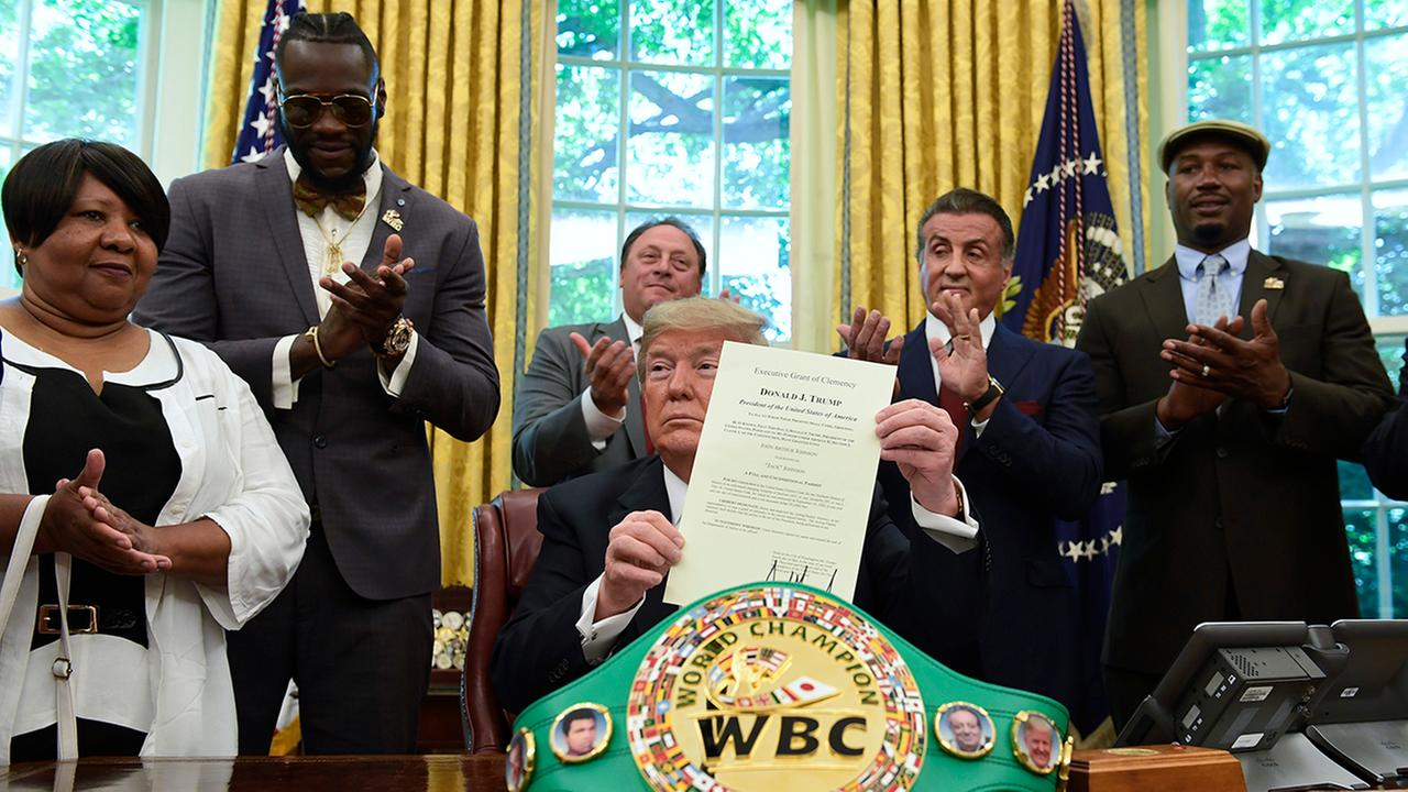 President Trump pardons Jack Johnson. From left, Johnsons great-great niece Linda Haywood, boxer Deontay Wilder, Keith Frankel, Sylvester Stallone, and former champ Lennox Lewis.