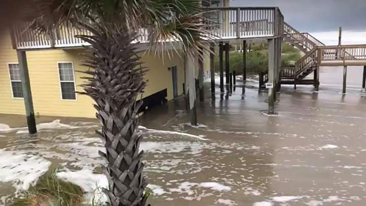 Flooding begins on north Topsail Island on Thursday as Hurricane Florence rolls in.