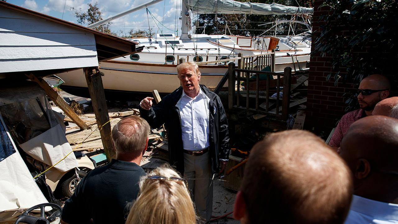 President Donald Trump visits a neighborhood impacted by Hurricane Florence, Wednesday in New Bern