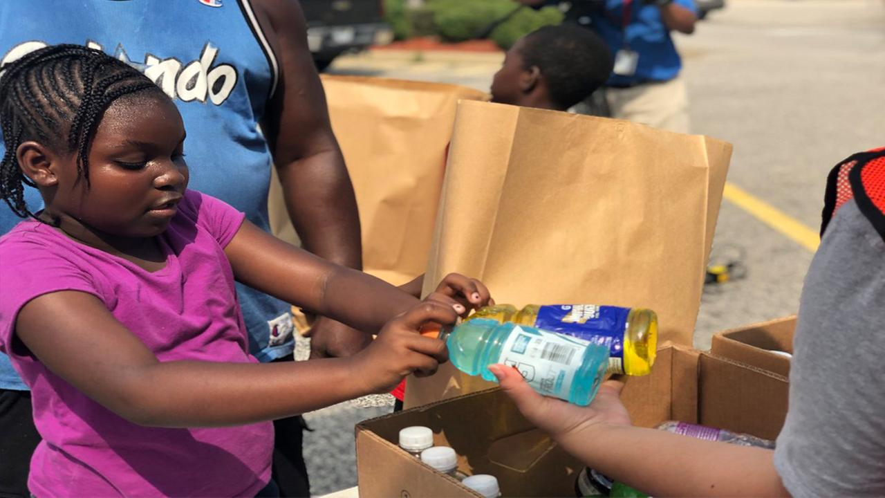 The Second Harvest Food Bank of Southeast NC and Grace Chapel Church give away food to those impacted by Hurricane Florence