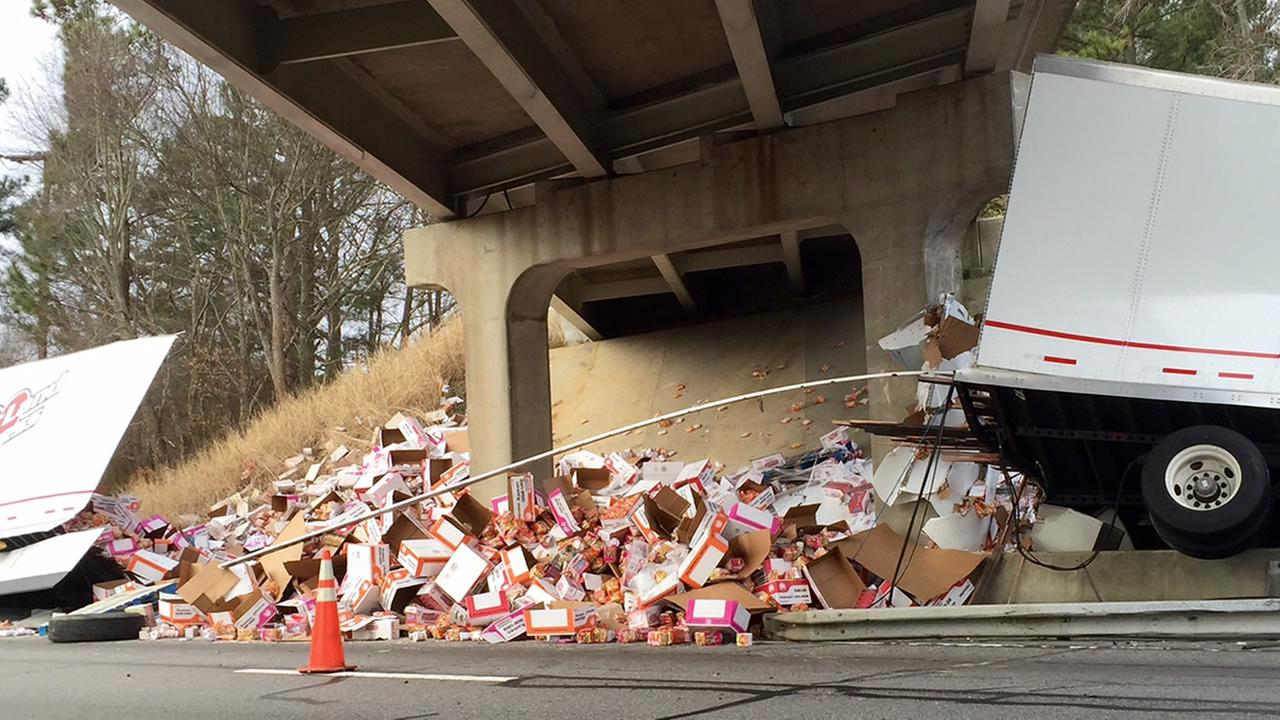 The truck carrying packets of noodles hit a bridge and broke apart.