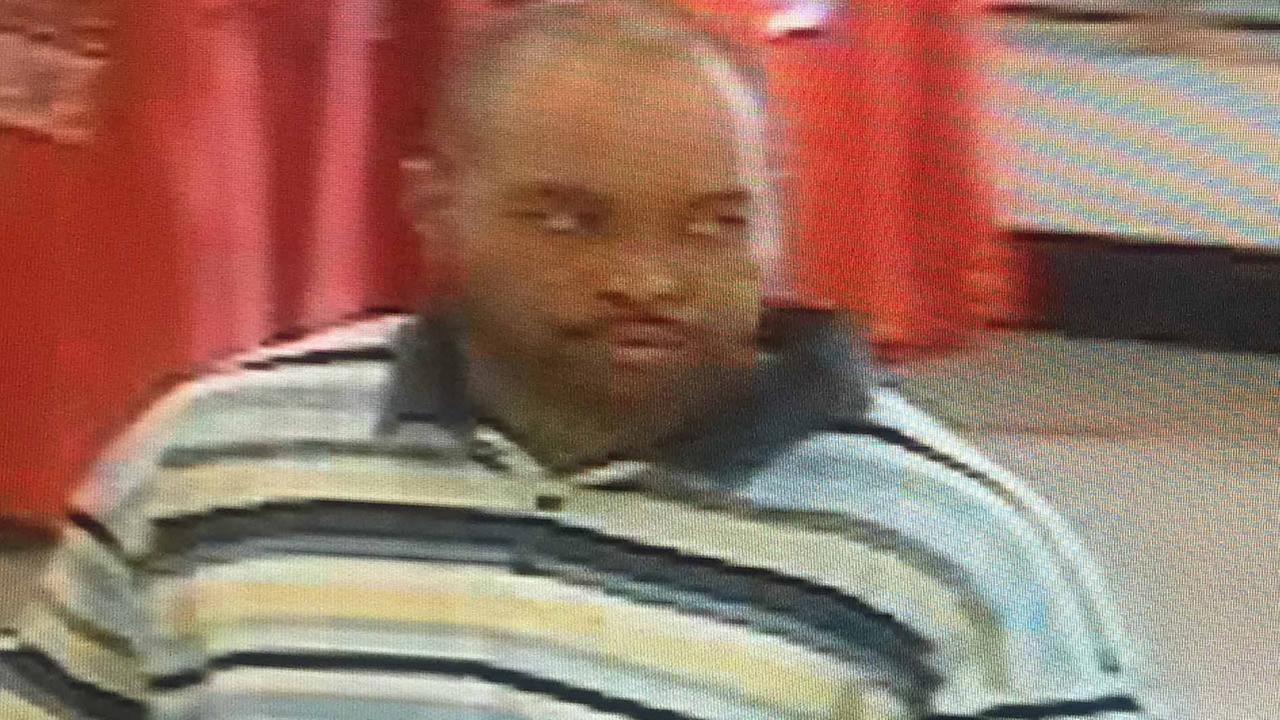 Investigators are looking for a man seen in a surveillance picture (image courtesy Raleigh Police Department)