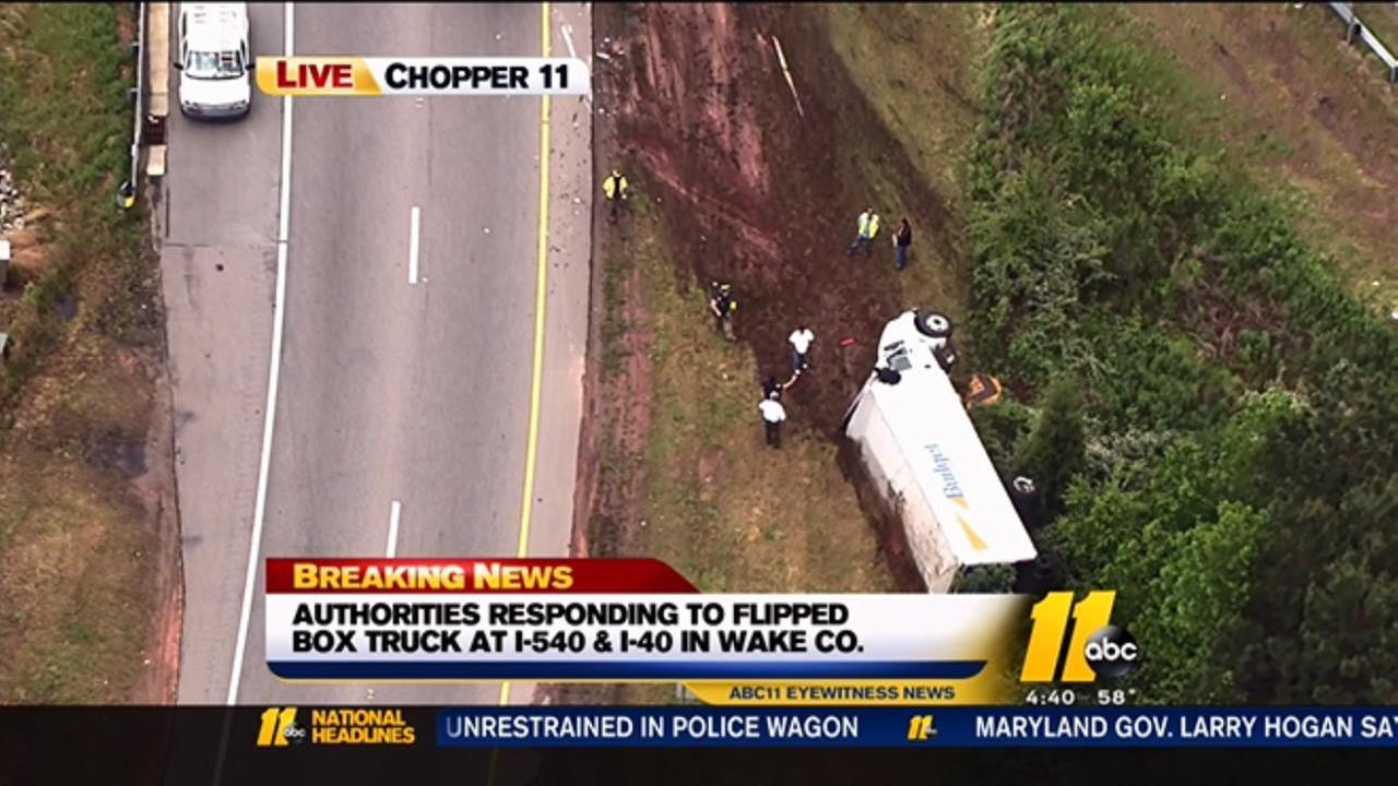 Box trucks flips on side on ramp from I-540 to I-40
