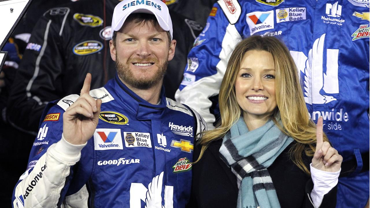 Dale Earnhardt Jr, left, poses with girlfriend Amy Reimann, right, at Daytona International (AP Photo/Terry Renna)