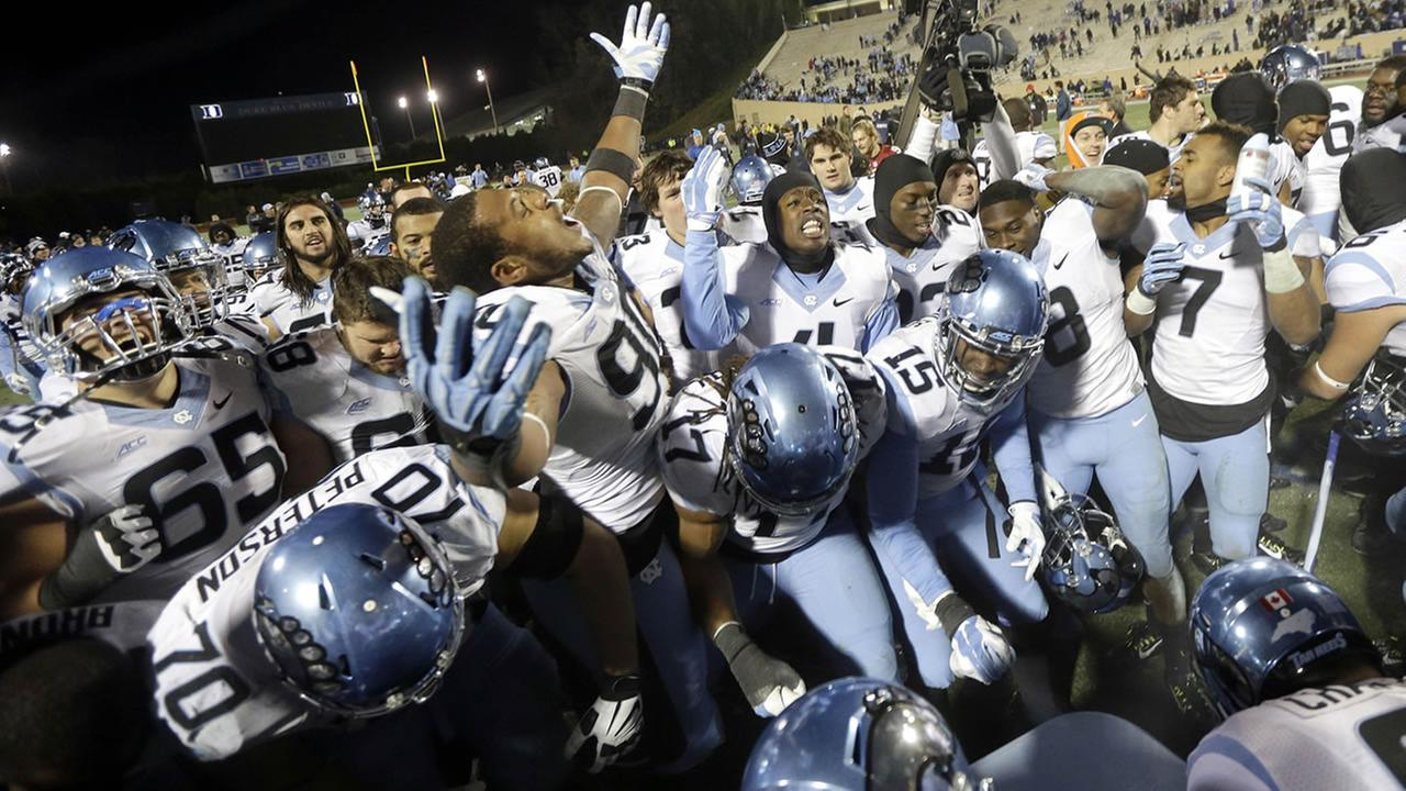 North Carolina players celebrate following a 45-20 win over Duke in an NCAA college football game in Durham, N.C., Thursday, Nov. 20, 2014.