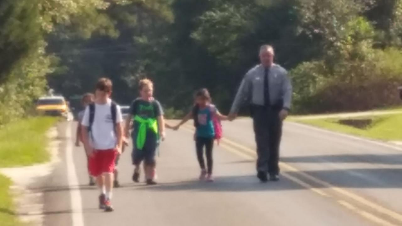 An ABC11 eyewitness sent us a photo of a North Carolina Highway Patrol officer escorting children in the neighborhood.