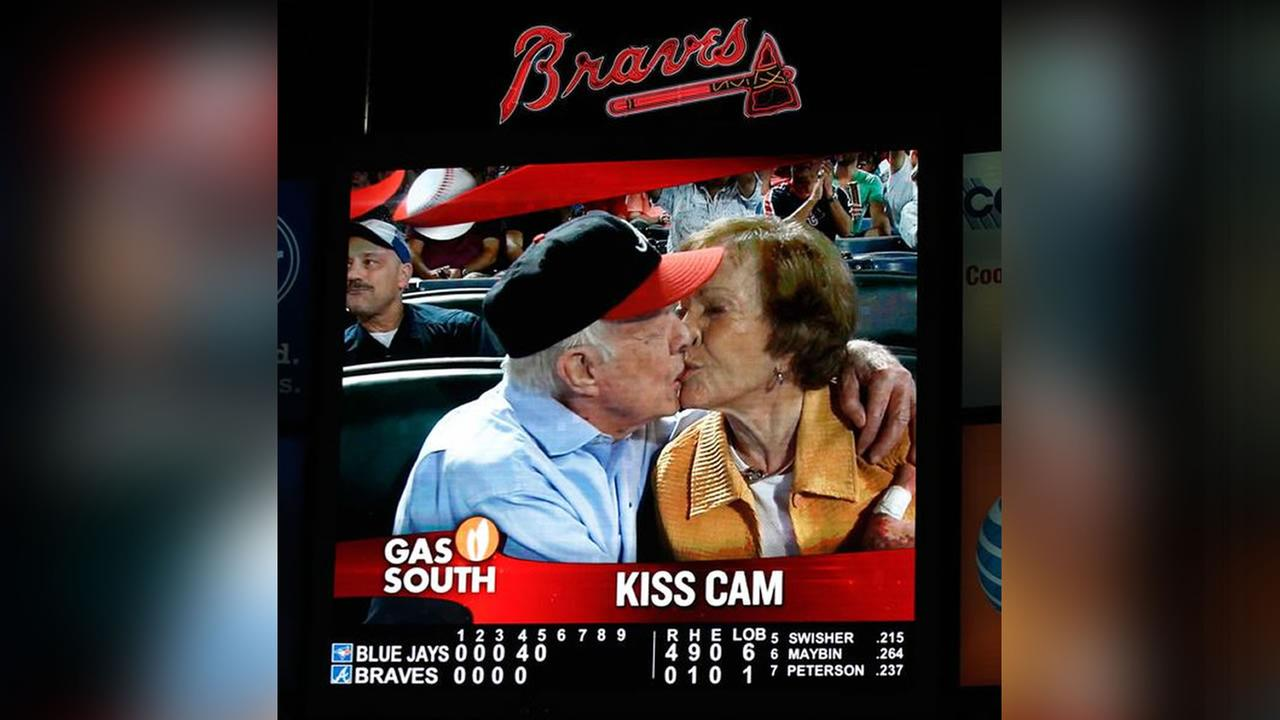 Former President Jimmy Carter smooching with wife Rosalynn on the Atlanta Braves Kiss Cam.